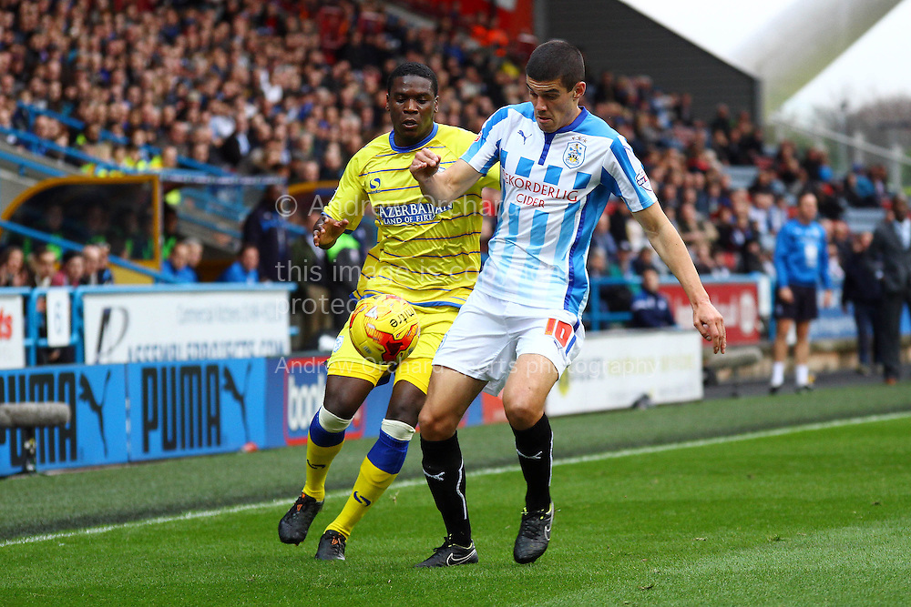 Conor Coady of Huddersfield Town looks to get in front of Jeremy Helan of Sheffield Wednesday. Skybet football league championship match, Huddersfield Town v Sheffield Wednesday at the John Smith's stadium in Huddersfield, Yorkshire on Saturday 22nd November 2014.<br /> pic by Chris Stading, Andrew Orchard sports photography.