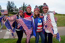 Auchterarder, Scotland, UK. 15 September 2019. Sunday Singles matches on final day  at 2019 Solheim Cup on Centenary Course at Gleneagles. Pictured; Enthusiastic Team USA fans with flag beside the 7th green. Iain Masterton/Alamy Live News