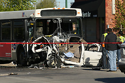 May 7, 2017 - Chicago, IL, USA - Investigators look over the scene of a fatal crash involving a CTA bus and a car, which killed four people on Sunday, May 7, 2017 in the 2600 block of West Madison Street in Chicago, Ill. Eight people were transported to the hospital from the scene. (Credit Image: © Stacey Wescott/TNS via ZUMA Wire)