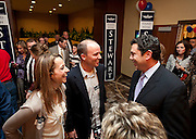 Rep. Jason Chaffetz, R-Utah, shares a laugh with Spencer Chase, center at the Utah Republican Party results party, Tuesday, Nov. 6, 2012.
