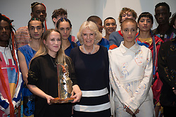 The Duchess of Cornwall (centre) with models after presenting designer Bethany Williams (centre left) with the Queen Elizabeth II Award for Design during a visit to London Fashion Week at the BFC Show Space, London.