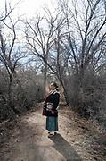 Denise Jensen, a teacher at at Navajo Preparatory School, stands for a portrait at Berg Park in Farmington New Mexico.
