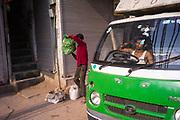 A man delivering vegetables in the early morning Sitaram Bazar, Old Delhi, India