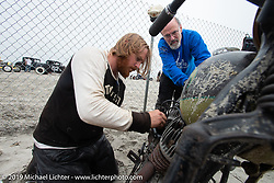 Morris Magneto founder Dave Shaw lends a hand to a broke down beach racer at