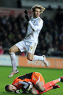Michu of Swansea city hurdles over Boro keeper Jason Steele. Capital one cup, quarter final, Swansea city v Middlesbrough at the Liberty Stadium in Swansea, South Wales on Wednesday 12th Dec 2012. pic by Andrew Orchard, Andrew Orchard sports photography,