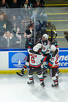 KELOWNA, BC - JANUARY 24: Matthew Wedman #20 celebrates the game winning goal with Mark Liwiski #9, Kaedan Korczak #6, Jonas Peterek #27 and the fans during overtime against the Seattle Thunderbirds the  at Prospera Place on January 24, 2020 in Kelowna, Canada. (Photo by Marissa Baecker/Shoot the Breeze)