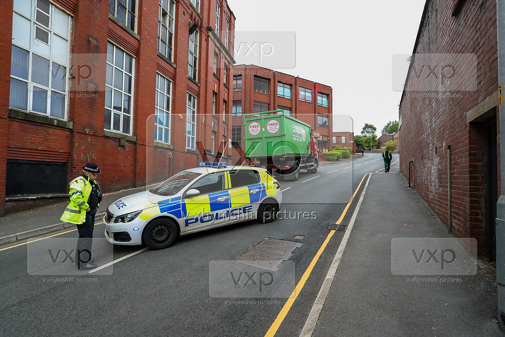 """Police arrived at the site after Palestine Action activists scaled the roof of """"Cairo House"""" in Oldham on Monday, June 21, 2021. This is the ongoing protest forms of the human rights activists group in Britain targeting an Israeli owned weapons manufacturer Elbit Systems. Activists argue that arms being manufactured in the facility are being used in indiscriminate attacks against the Gaza Strip. (VX Photo/ Vudi Xhymshiti)"""