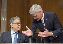 July 13, 2017 - Washington, District of Columbia, United States of America - United States Senators Al Franken (Democrat of Minnesota), left, and Bill Cassidy (Republican of Louisiana) in discussion prior to the start of the US Senate Committee on Health, Education, Labor, and Pensions meeting on Capitol Hill in Washington, DC on Thursday, July 13, 2007.Credit: Ron Sachs / CNP (Credit Image: © Ron Sachs/CNP via ZUMA Wire)