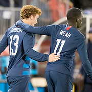 EAST HARTFORD, CONNECTICUT- October 16th: Josh Sargent #13 of the United States is congratulated by Tim Weah #11 of the United States after scoring during the United States Vs Peru International Friendly soccer match at Pratt & Whitney Stadium, Rentschler Field on October 16th 2018 in East Hartford, Connecticut. (Photo by Tim Clayton/Corbis via Getty Images)
