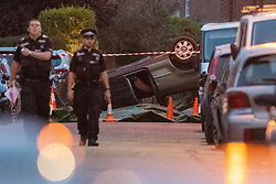 © Licensed to London News Pictures. 22/07/2020. Thame, UK. An overturned vehicle on Chinnor Road with a tarpaulin held down by road cones to the side of the vehicle. Thames Valley Police has launched a murder investigation in Thame. At approximately  19:05BST a man was found with injuries in Chinnor Road, Thame. The 20-year-old man was pronounced dead at the scene. Photo credit: Peter Manning/LNP