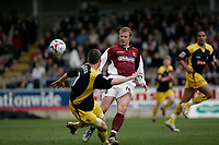 Photo: Marc Atkins.<br /> <br /> Northampton Town v Stockport County. Coca Cola League 2. 17/04/2006. Northampton Town's Gavin Johnson(R)chips the ball past Stockport's Mark Robinson (L).