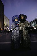 Costumed revelers during Winter Carnival in the Piazza San Marco in Venice, Italy.