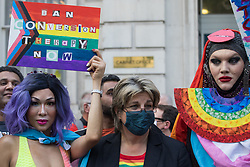 London, UK. 23rd June, 2021. Campaigners against LGBT+ conversion therapy, including Jayne Ozanne of the Ban Conversion Therapy Coalition (c), attend a picket outside the Cabinet Office and Government Equalities Office. They also handed in a petition signed by 7,500 people calling on the government to fulfil its 2018 promise to ban LGBT+ conversion therapy.