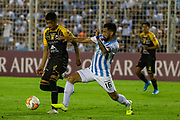 Raul Castro of Bolivia's The Strongestt (left) and Ariel Rojas of Argentina´s Atletico Tucumán  (right) battle for the ball during a Copa Libertadores soccer match at the Jose Fierro Monumental Stadium, Wednesday, Feb. 12, 2020, in Tucuman, Argentina. (Florencia Tan Jun/Image of Sport via AP)