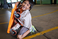 Mauricio Reyes, 6, and his orange scooter at the Breadbox in east Salinas.