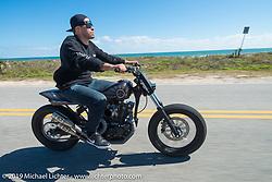 "Zach Ness of Arlen Ness Motorcycles in Dublin, CA out for a ride on his custom Ironhead Sportster ""Street-Tracker"" during Daytona Bike Week. FL, USA. March 14, 2014.  Photography ©2014 Michael Lichter."