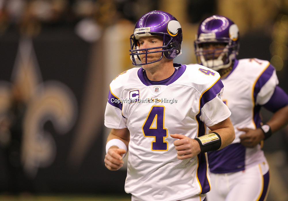 Jan 24, 2010; New Orleans, LA, USA; Minnesota Vikings quarterback Brett Favre (4) on the field during warm ups before kickoff of a 31-28 overtime victory by New Orleans Saints over the Minnesota Vikings in the 2010 NFC Championship game at the Louisiana Superdome. Mandatory Credit: Derick E. Hingle-US PRESSWIRE