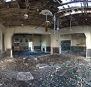 June 2014. The last of the pressed-tin panels have been ripped from the walls in this area.