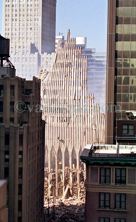 18 September 2001. New York, New York - USA.<br /> Post 9/11 World Trade Center attack.<br /> Looking down upon the remains of the World Centre Twin Tower complex a week after the coordinated Al Queda terror attack. The view is from the apartment of John Philips, a resident granted special permission to enter his once luxury apartment just 2 blocks from where the World Trade Center Twin Towers used to stand. His apartment is now filled with dust and debris from the collapsed towers. John and residents of the building were evacuated following the attack which cut off water and electricity supplies. A week after the attack, residents were given just 15 minutes to gather necessary belongings and leave their apartments which by default rendered them homeless. Residents were warned to check their balconies for victims of the Twin Towers who might have fallen to their deaths.<br /> In the chaos of 9/11, John's sister Dr Sneha Ann Philip disappeared. John claimed she used to walk past the Twin Towers every morning on her way to work. He fears she might be a victim of the coordinated Al Qaeda attack which claimed over 2,000 victims at the site of the Twin Towers.<br /> It was later discovered that his sister was indeed just one more of the many victims killed in the attack.<br /> Photo exclusive©; Charlie Varley/varleypix.com