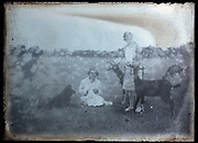 two women with goats and dog in a farmers field France circa 1920s