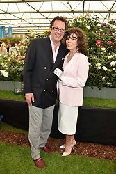 Dame Joan Collins and Percy Gibson at the RHS Chelsea Flower Show Press Day, Royal Hospital Chelsea, London England. 22 May 2017.<br /> Photo by Dominic O'Neill/SilverHub 0203 174 1069 sales@silverhubmedia.com