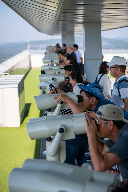 Visitors, mostly South Korean, use binoculars to look into North Korea from the Dora Observatory, a public viewing platform free and open to visitors, on the South Korean side of the DMZ. (September 29, 2019)