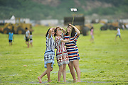 QINGDAO, CHINA - JULY 20: (CHINA OUT) <br /> <br /> Seaweed Swamps Qingdao Coastline<br /> <br /> Tourists play at a beach covered by a thick layer of green algae on July 20, 2015 in Qingdao, Shandong Province of China. A large quantity of non-poisonous green seaweed, enteromorpha prolifera, hit the Qingdao coast in June and July this year.<br /> ©Exclusivepix Media