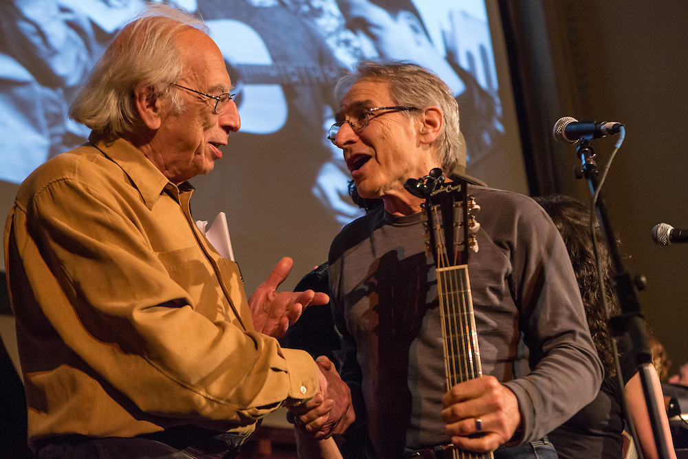 After the concert, Happy Traum, on the right, has a chat with Izzy Young, founder of the Folklore Center in New York, the former center of the folk revival of the 1950s and 60s.