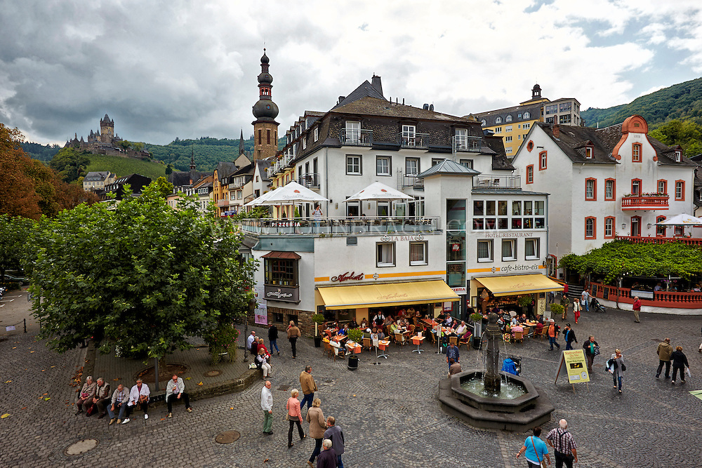 View of Downtown Cochem, Emily's Wein-Cafe, Tower, and Cochem Castle in the background, Cochem, Germany.