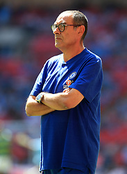 """Chelsea manager Maurizio Sarri before the Community Shield match at Wembley Stadium, London. PRESS ASSOCIATION Photo. Picture date: Sunday August 5, 2018. See PA story SOCCER Community Shield. Photo credit should read: Mike Egerton/PA Wire. RESTRICTIONS: EDITORIAL USE ONLY No use with unauthorised audio, video, data, fixture lists, club/league logos or """"live"""" services. Online in-match use limited to 75 images, no video emulation. No use in betting, games or single club/league/player publications."""