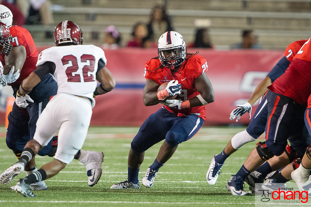 MOBILE, AL - OCTOBER 24: Running back Kendall Houston #29 of the South Alabama Jaguars carries the ball through traffic during their game against the Troy Trojans on October 24, 2014 at Ladd-Peebles Stadium in Mobile, Alabama.  The South Alabama Jaguars defeated the Troy Trojans 27-13. (Photo by Michael Chang/Getty Images) *** Local Caption *** Kendall Houston