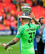 Ederson Moraes (31) of Manchester City walks to the podium on the pitch with the FA Cup on his head during the The FA Cup Final match between Manchester City and Watford at Wembley Stadium, London, England on 18 May 2019.