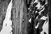 A young man ice climbing in Hyalite Canyon near Bozeman, Montana.