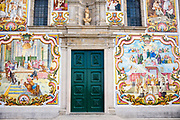 Doorway of church decorated with traditional tiles depicting religious scenes at Valega near Ovar in Portugal