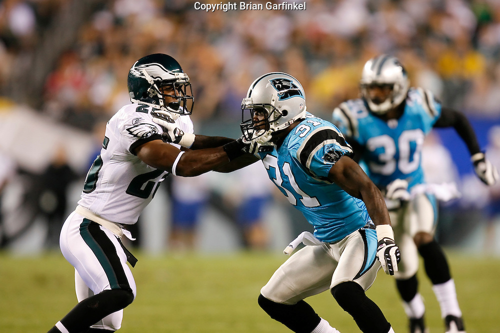 8 August 2008: Philadelphia Eagles running back Lorenzo Booker #25 comes into contact with Carolina Panthers cornerback Richard Marshall #31 during the game against the Carolina Panthers on August 14, 2008. The Eagles beat the Panthers 24 to 13 at Lincoln Financial Field in Phialdelphia, Pennsylvania.
