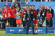 Portugal Forward Cristiano Ronaldo grabs Portugal Manager Fernando Santos to celebrate during the Euro 2016 final between Portugal and France at Stade de France, Saint-Denis, Paris, France on 10 July 2016. Photo by Phil Duncan.