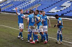 Jonson Clarke-Harris of Peterborough United celebrates scoring the winning goal with team-mates - Mandatory by-line: Joe Dent/JMP - 27/02/2021 - FOOTBALL - Weston Homes Stadium - Peterborough, England - Peterborough United v Wigan Athletic - Sky Bet League One