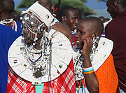 Maasai women in full traditional party outfit, wearing Maasai jewelry. Maasai is an ethnic group of semi-nomadic people Photographed in Tanzania