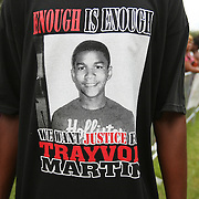 A pro-Trayvon demonstrator wears a t-shirt in the protest area, prior to the trial of George Zimmerman at the Seminole County Courthouse, Saturday, July 13, 2013, in Sanford, Fla. Zimmerman had been charged for the 2012 shooting death of Trayvon Martin. Zimmerman was found not guilty by a jury of six women. (AP Photo/Alex Menendez)