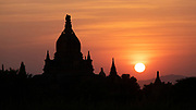 Sunset in Bagan, an ancient city and a UNESCO World Heritage Site in the Mandalay Region of Myanmar. In the Bagan plains alone the remains of over 2200 temples and pagodas survive.