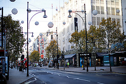 "© Licensed to London News Pictures. 25/11/2016. London, UK. Deserted streets and empty shops in the early hours on Oxford Street in central London on ""Black Friday"". Sales from this years Black Friday event are expected to top £2 billion. Photo credit: Tolga Akmen/LNP"