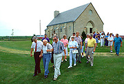 Family leaving church for burial after funeral.  Cambria Wisconsin USA