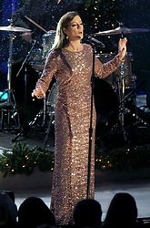 Sarah Mclaughlin performs in the rain at the annual Christmas Tree Lighting Ceremony at the Rockefeller Center in New York City, NY, USA, on November 30, 2016. Thousands of revelers crowded the sidewalks for the event. The Tree will remain lit and can be viewed until 9pm on January 7, 2017. Photo by Dennis Van Tine/ABACAPRESS.COM