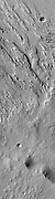 As with most of the wind eroded material southwest of Olympus Mons and south of Elysium Mons, two directions of winds are recorded.