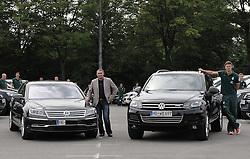 03.08.2011, Parkplatz2, Bremen, GER,, Fahrzeuguebergabe Werder Bremen, im Bild Klaus Allofs (Geschaeftsfuehrer Profifussball Werder Bremen, links) mit seinem VW Phaeton, Sebastian Prödl / Proedl (Bremen #15, rechts) mit seinem VW Touareg..// VW vehicle handover Werder Bremen Fahrzeuguebergabe Werder Bremen on 2011/08/03, Parkplatz2, Bremen, Germany..EXPA Pictures © 2011, PhotoCredit: EXPA/ nph/  Frisch       ****** out of GER / CRO  / BEL ******