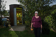 Finchley Horticultural Society, founded in 1940 as The West Finchley (Wartime) Allotments Association, part of the 'Dig for Victory' campaign. Photo shows Helen Skelton outside the Kazubaloo KL2 waterless toilet on the Gordon Road Allotments in Finchley, North London, Britain.