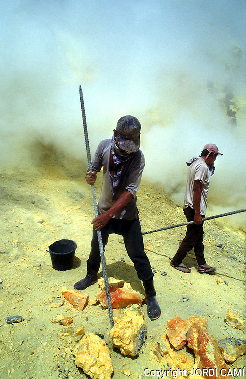 Mining  sulphur  by hand  in  the active crater of Volcano Kawa Ijen. Eastern Java, Indonesia