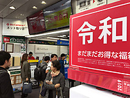 """April 30, 2019, Tokyo, Japan: As Japan enters the Reiwa Era, a numbered of business ushered in the new era with special promotional campaigns. At Tokyo's Bic camera, one of the nation's largest electronic retailer, they were offering prizes, gifts and specially priced """"fukubukuro"""" or lucky bags with deeply discounted mystery items contained within. Their slogan for this campaign was """"Happy New Era"""" and the Kanji characters for Reiwa were displayed everywhere, including the back of employees' shirts. As Japanese Emperor Akihito abdicated the Chrysanthemum Throne, this brought an end to the Heisei Era (Jan. 8, 1989 to Apr. 30, 2019). The new era called 'Reiwa"""" begins May 1, 2019 when Crown Prince Naruhito ascends the throne. The two kanji characters """"'rei"""" and """"wa"""" can be translated as either """"fortunate harmony"""" or """"peace in harmony"""" and were taken from a stanza about plum blossoms in Man'yoshu, a collection of Japanese poetry written sometime after 759. Japanese calendars years are based upon the reigns of it's emperor's."""