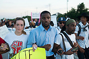 (Center) Dominique R. Alexander, president and founder of Next Generation Action Network, leads a protest at Craig Ranch North in response to an incident with teens and police officers at a community pool in McKinney, Texas on June 8, 2015.  (Cooper Neill for The New York Times)