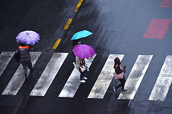 South Africa - Johannesburg - 05 September 2020 - Women with umbrellas protect themselves from the rain, most parts of Gauteng experienced severe thunderstorm.<br /> Picture: Itumeleng English/African News Agency(ANA)